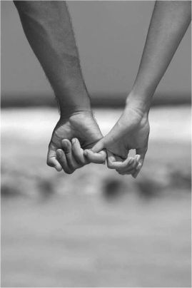 Couple holding hands B + W